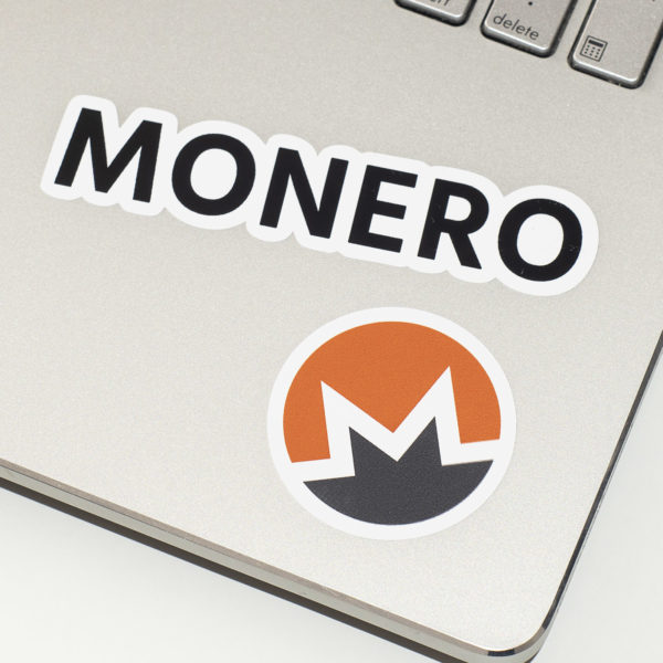 Monero Sticker with Logo and Text on Laptop Keyboard